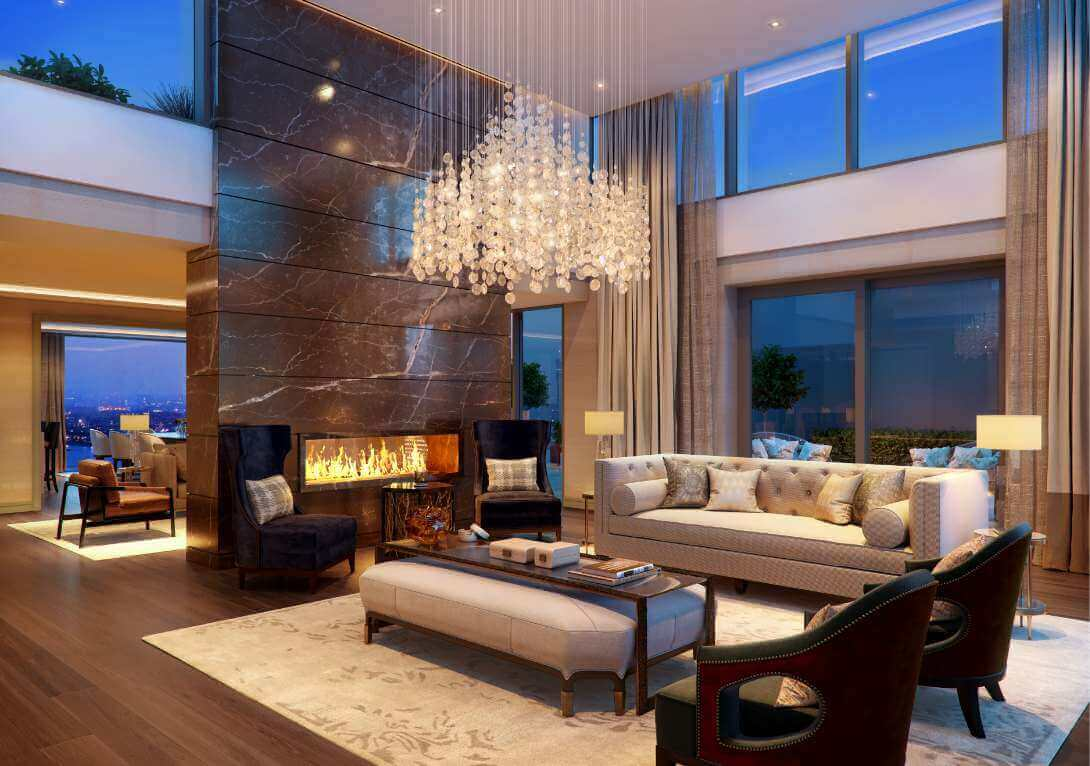 Double height living room with custom chandelier and feature fireplace with marble floor to ceiling surround